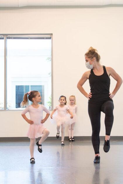 Little Emily with her teach going across the floor, so cute